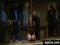 Tied up Asian slave gets tortured by two ninjas in BDSM clip