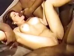 White brunette takes on a group of big black cocks in gangbang