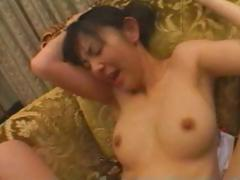 Japanese babe sucks on his cock and then gets fucked hard