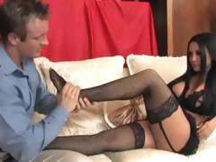Brunette babe uses her talented feet to jack off this cock