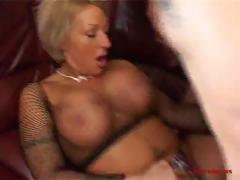 Busty MILF bends over the couch to take his cock deep and then sucks