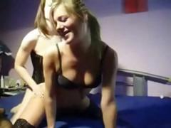 Two hot lesbian babes are using a strapon to do some fucking