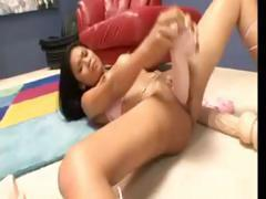 Sexy Asian babe uses a large dildo to fuck her wet pussy