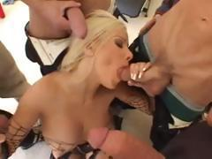 Busty blonde takes on three cocks and sucks and fucks for facial