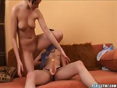 Two lesbian babes use a strap on to fuck and also eat pussy
