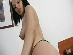 Amateur brunette masturbating with a dildo in the hotel room