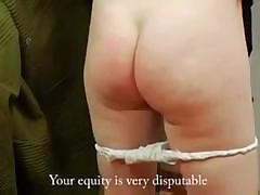 Pigtailed girl sticks out her round ass so she can get spanked