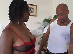 Busty black bitch gets his black cock in her mouth and pussy