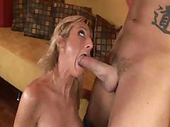 Nice looking mom sucking and fucking that young stud's hard dick