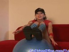 Skinny teen bouncing on ball