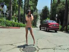 Jennifer White takes off her small bikini on public street.