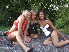Three horny lesbians have a hot orgy outdoors