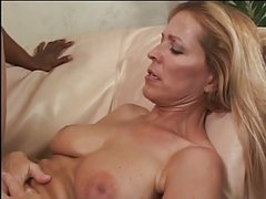 Blonde slut loves getting titty fucked by big black cock in her tight cunt