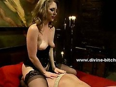 Man cuffed and tied to the wall abused and dominated by pervert mistress in femdom divine sex