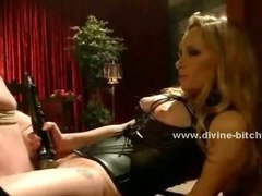 Experienced mistress with gorgeous body and face dressed in an oriental outfit torments man slave