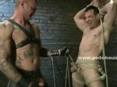 Gay sex slave gets bound and flogged by a dominating and tattooed Master that makes him suck cock