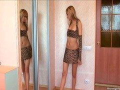 Shy young amateur stripping on front of the mirror