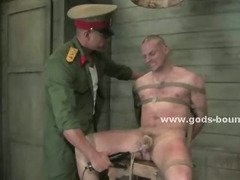 Gay soldier gets his torso covered in clothes pins by his commanding officer