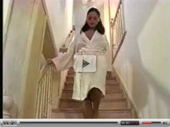 British slut Nadia plays with herself on the stairs