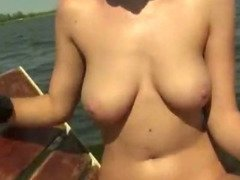 Babe exposed her big tits and pounded on the boat with stranger