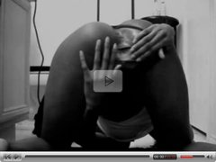 Ebony woman showing on bathroom floor