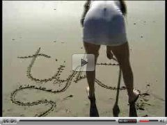 White chick vs Black Snake on the beach
