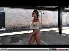 Black chick playing naked in public