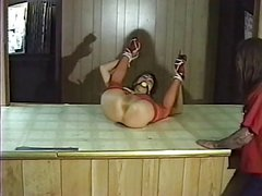 Sexy asian in red fishnets bound and gagged by her master