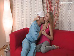 Blonde in love with hard cock on the red couch
