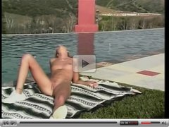 Hardbodied couple enjoys outdoor fuck by the pool