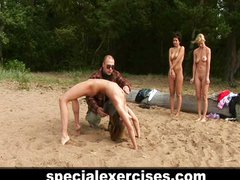 Submissive naked training on the beach