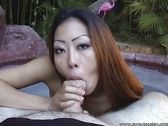 Asian amateur gives an outdoor blowjob