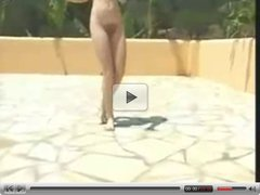 Dancing naked by the pool