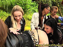 Lez group pissing outside with dildo play