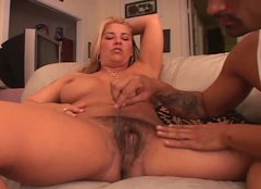 Busty and slightly chubby blonde gets her hairy pussy licked
