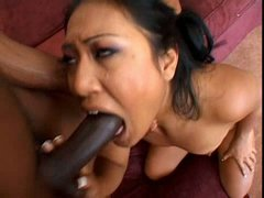 Fuckable Asian doxy gets her face jizzed after fuck in missionary style by huge black cock