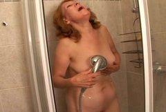 Mature woman is taking a shower and having sex fun with her husband