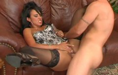 Buxom brunette whore in black stockings gives hot blowjob to her lover