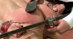 Doctor spanks his patient's ass with a leather paddle in rough BDSM way