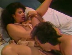Alluring raven haired MILF gets boned missionary style
