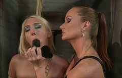Sexy blonde girl is tied up and sexually totured by two tough mistresses