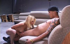 Kinky blond haired buxom hottie kneels down to give a solid blowjob