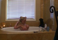 Juggy blonde porn actress Savannah Gold is taking a bath