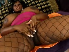 Chubby ebony slut with saggy monstrous boobs gets her pussy licked