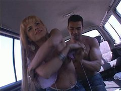 Shemale chick in short jeans skirt gives her head in the car