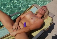 Chubby blonde mommy is bathing in a pool naked and then masturbating on a deck chair
