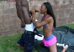 Booty flat chested ebony chick Marie Luv gives her head outdoor