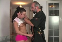 Memserizing brunette student kneels down to mouth fuck hard cock of horny dad