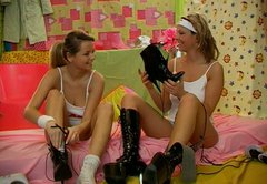 Playful Russian teens in leather jackboots please one another in a hot lesbian porn clip