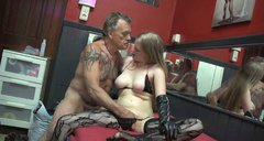 Tattooed oldie Axel from Denmark rubs the wet cunt of blond whore in brothel